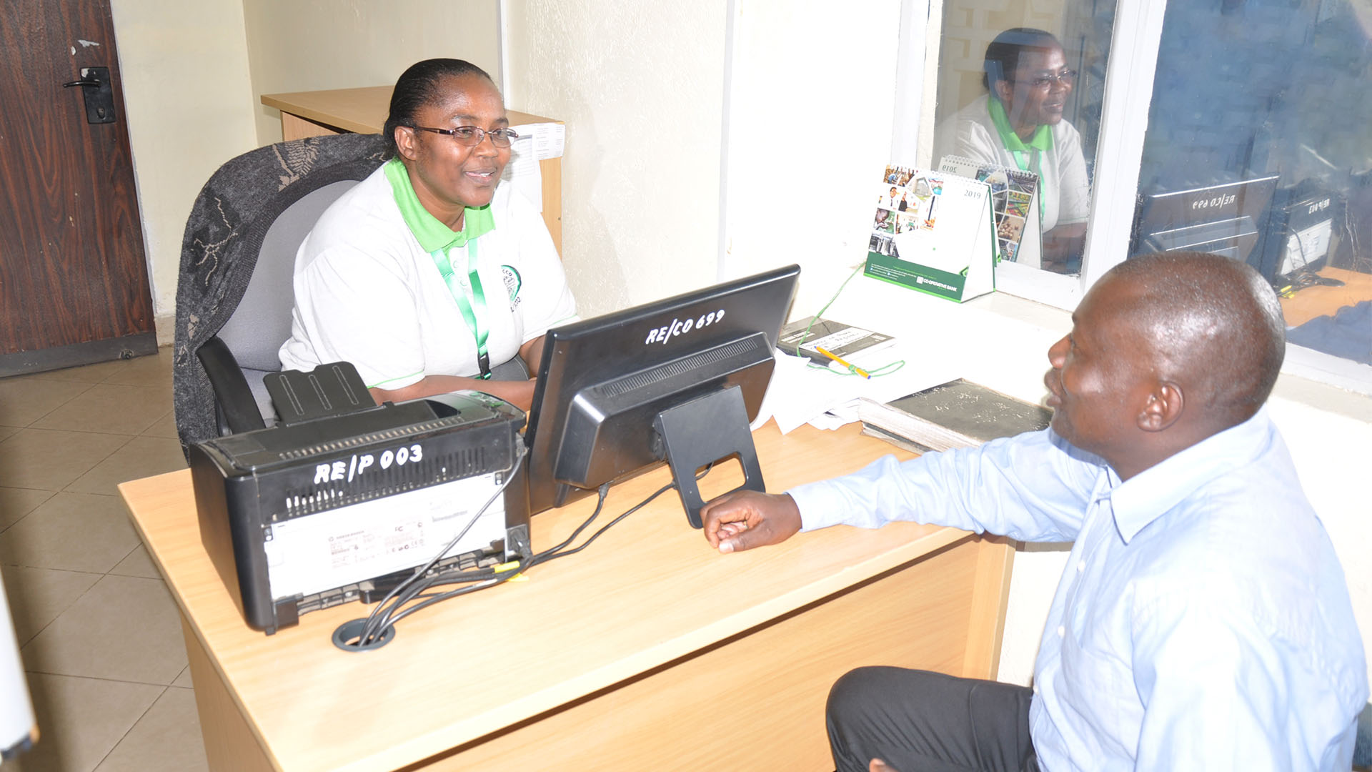 Reli Sacco Staff Serving Clients (12)